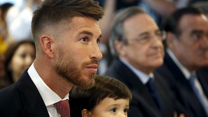 Real Madrid's Spain defender Sergio Ramos and his son Sergio look on before a news conference at Santiago Bernabeu stadium in Madrid