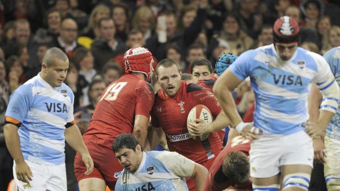 Wales' Ken Owens holds the ball after scoring a try against Argentina during their international rugby union match at the Millennium Stadium in Cardiff