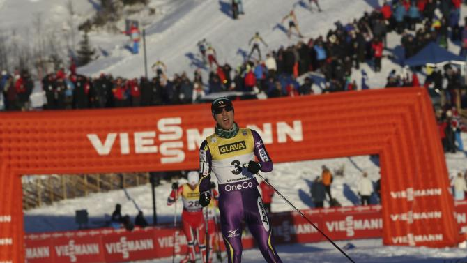 Akito Watabe of Japan crosses the finish line to come in second-placed at the Nordic Combined World Cup competition in Lillehammer