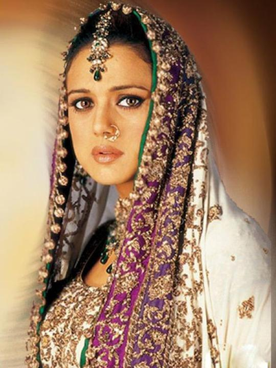 Images via : iDiva.comPreity Zinta plays a Pakistani Muslim bride in the film Veer Zara. She's wearing a white lehenga complete with zardosi and purple border.Related Articles - Style Tips from Sexy C