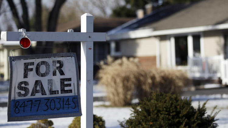 "In this  Jan. 5, 2013, photo a ""for sale"" sign is seen outside a home in Glenview, Ill. Five of the biggest U.S. banks have cut struggling homeowners' mortgage balances by $19 billion, part of a total $45.8 billion in relief provided under a landmark settlement over foreclosure abuses. (AP Photo/Nam Y. Huh)"
