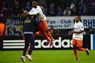 Montpellier's Souleymane Camara celebrates scoring with staff and teammate Joris Marveaux (R) during their UEFA Champions League Group B match against Schalke 04 in Gelsenkirchen, western Germany. A 90th-minute equaliser from Camara saw ten-man Montpellier take an unexpected point in a 2-2 draw