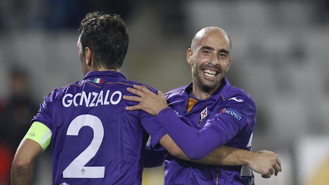 Fiorentina's Borja Valero, right, celebrates with Gonzalo Rodriguez, left, after scoring in the dying moments of an Europa League, group E match, between Fiorentina and Pandurii, at the Cluj Arena stadium in Cluj, Romania, Thursday, Nov. 7,  2013
