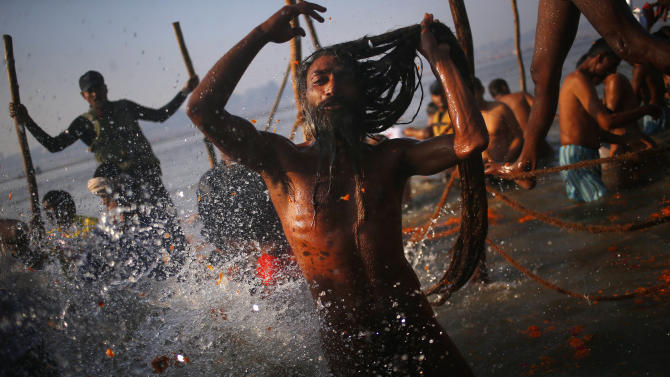 "A ""Naga"" sadhu or Hindu naked holy man takes a dip at ""Sangam,"" the confluence of Hindu holy rivers Ganges, Yamuna and the mythical Saraswati, during the Maha Kumbh festival at Allahabad, India, Sunday, Feb. 10, 2013. Millions of devout Hindus and thousands of Hindu holy men are expected to take a dip at Sangam on Sunday, the most auspicious day according to the alignment of stars, for the entire duration of Maha Kumbh festival, which lasts for 55 days. (AP Photo/ Saurabh Das)"