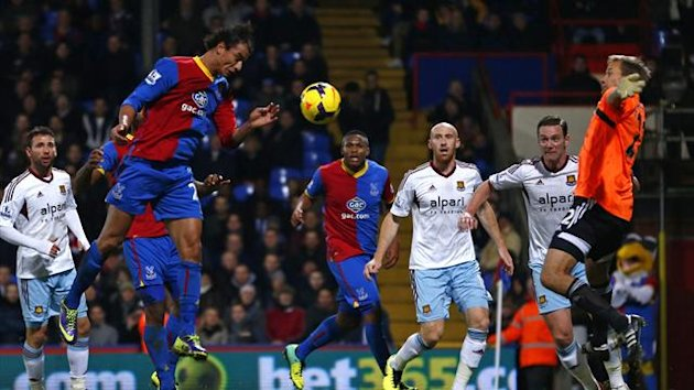 Crystal Palace's Marouane Chamakh (L) scores a goal against West Ham (Reuters)