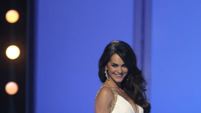 Miss Ukraine Olesia Stefanko wears an evening gown as she competes at the Miss Universe pageant in Sao Paulo, Brazil, Monday, Sept. 12, 2011. Stefanko was named first runner up. (AP Photo/Andre Penner)