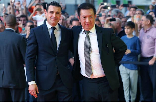 Valencia's President Amadeo Salvo (L) and owner Peter Lim during the Spanish League football match Valencia FC vs Elche CF at the Mestalla stadium in Valencia on October 25, 2014