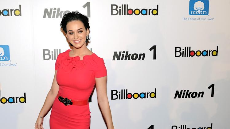 """Woman of the Year"" honoree, singer Katy Perry, attends Billboard's ""Women in Music 2012"" luncheon at Capitale on Friday Nov. 30, 2012 in New York. (Photo by Evan Agostini/Invision/AP)"
