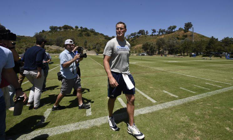 Philip Rivers walks off the field after Thursday's minicamp practice, the last in San Diego before the team moves. (AP)