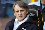 Manchester City's manager Roberto Mancini has said rivals Manchester United will still be favourites for the Premier League title, even if City win the derby at Eastlands on April 30