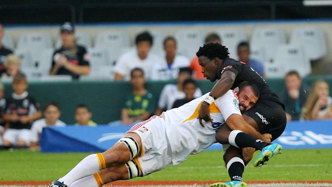 New Zealand Waikato Chiefs' Alex Bradley (L) tackles Sharks of Durban's Lwazi Mvovo during the Super 15 rugby union match Sharks of Durban vs Waikato Chiefs of New Zealand at the Mr Price Kings Park Rugby Stadium on April 21, 2012. AFP PHOTO/ STR (Photo credit should read -/AFP/Getty Images)