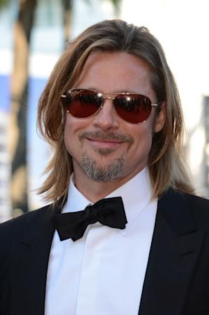 Brad Pitt arrives for the screening of 'Killing them Softly' presented in competition at the 65th Cannes film festival, Cannes, France, on May 22, 2012 -- AFP
