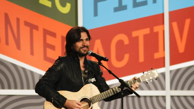 Colombian singer Juanes performs a Woody Guthrie song during the SXSW Music Festival in Austin, Texas on Thursday, March 15, 2012.(AP Photo/Jack Plunkett)