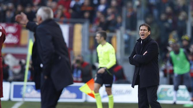 AS Roma coach Rudi Garcia of France gives directions to players during an Italian Serie A soccer match between Lazio and AS Roma at Rome's Olympic stadium, Sunday, Feb. 9, 2014