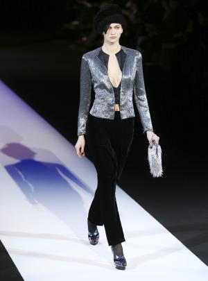 A model wears a creation for Giorgio Armani women's Fall-Winter 2013-14 collection, part of the Milan Fashion Week, unveiled in Milan, Italy, Monday, Feb. 25, 2013. (AP Photo/Antonio Calanni)