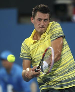 Tomic loses shortest match on record