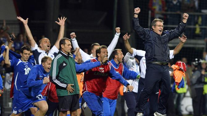 Bosnia's coach Safet Susic celebrates with his team after their 2014 World Cup qualifying soccer match against Slovakia in Zilina