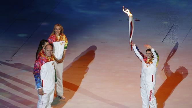 Sochi Winter Olympics 2014: President Putin's Girlfriend Alina Kabayeva Carries Olympic Torch
