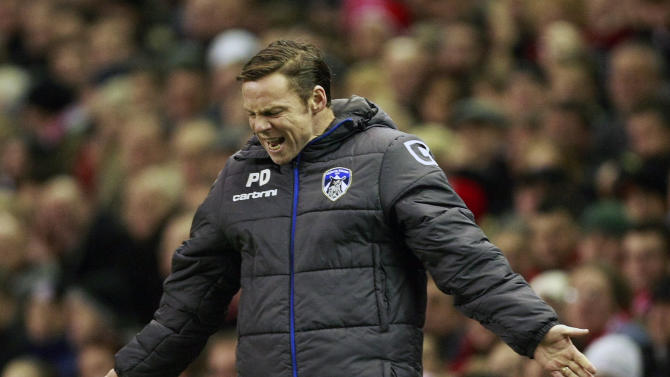 Oldham Athletic manager Paul Dickov reacts during their FA Cup third round soccer match against Liverpool at Anfield, Liverpool, England, Friday Jan. 6, 2012. (AP Photo/Tim Hales)