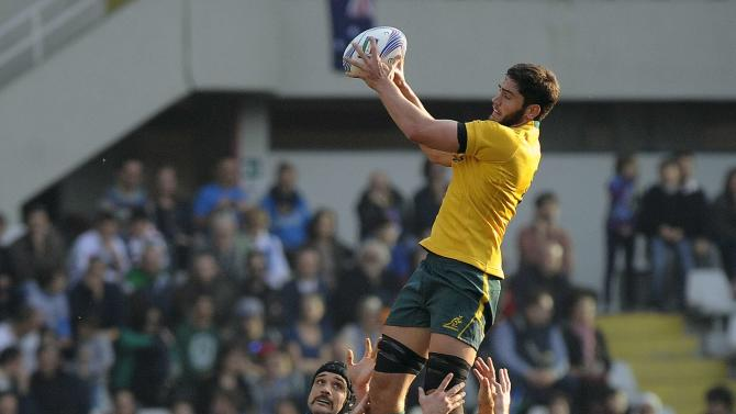 Australia's Rob Simmons jumps for the ball during their Six Nations rugby union match against Italy at the Olympic stadium in Turin