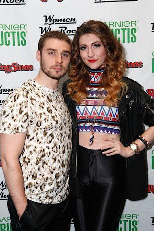 Nick Noonan and Amy Heidemann of Karmin perform at the Rolling Stone's Women Who Rock Concert at the Hard Rock Cafe sponsored by Belvedere Vodka in Times Square in New York City