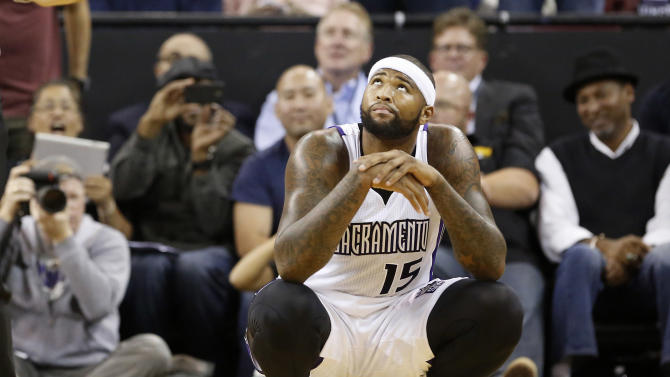 Sacramento Kings  center DeMarcus Cousins looks up at the scoreboard after being called for his sixth foul  and final foul during the fourth quarter against Brooklyn Nets in an NBA basketball game in Sacramento, Calif., Wednesday, Nov. 13, 2013. The Kings won 107-86