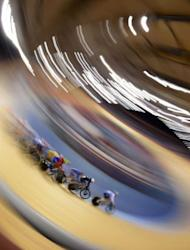 Cyclists compete during the London 2012 Olympic Games women's omnium elimination race cycling event at the Velodrome in the Olympic Park in East London