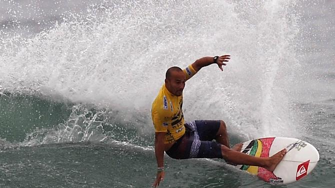 US surfer Fredrick Patacchia, from Hawaii, competes in the Association of Surfing Professionals' men's 2012 ASP World Championship Tour at Barra da Tijuca beach in Rio de Janeiro, Brazil, on May 14, 2012.  AFP PHOTO/VANDERLEI ALMEIDAVANDERLEI ALMEIDA/AFP/GettyImages