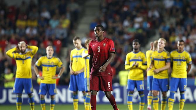 SOC: Portugal's William Carvalho before taking his penalty during the shootout