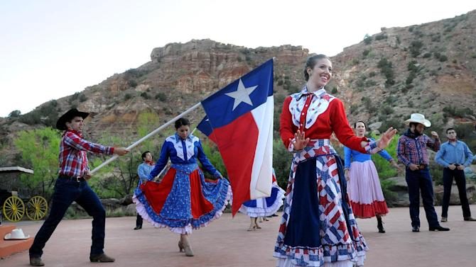 "In this May 21, 2013 photo, ""Texas"" cast members rehearse on stage at the Pioneer Amphitheatre in Palo Duro Canyon, Texas. Five cast members of the musical were killed in an automobile accident Monday night, Aug. 12, 2013 near Dumas, Texas, said Christopher Ray, a Texas Department of Public Safety spokesman. (AP Photo/Amarillo Globe-News, Sean Steffen)"