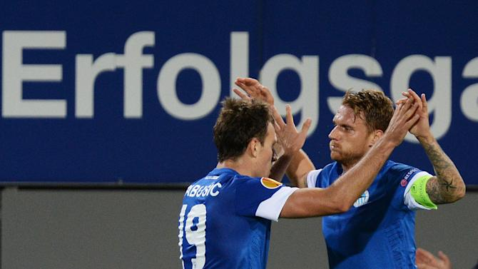 Scorer Michal Rabusic , left,  and Radoslav Kovac , of Liberec jubilate  after scoring the 2=2 draw during the UEFA Europa League Group H  soccer match between SC Freiburg and Slovan Liberec FC  in Freiburg, Germany,  Thursday Sept. 19,  2013