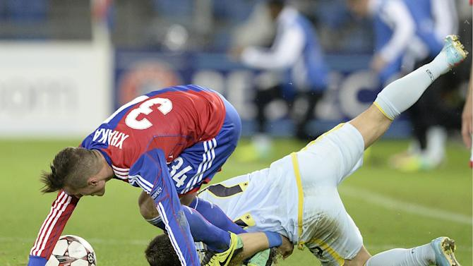 Basel's Taulant Xhaka, left, fights for the ball against Steaua's Adrian Popa, during a Champions League group E group stage match between Switzerland's FC Basel 1893 and Romania's FC Steaua Bucharest at the St. Jakob-Park stadium in Basel, Switzerland, Wednesday, Nov. 6, 2013