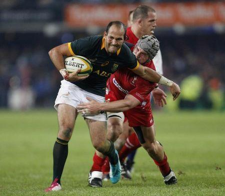 South Africa's du Preez fends off the tackle of Wales' Davies during their rugby test match in Durban