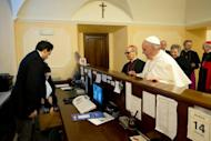 Pope Francis at the reception desk of the Domus Internationalis Paulus VI residence as he pays the bill for his stay, on March 14, 2013 in Rome in a photo released by the Vatican press office. The first non-European pontiff in more than 1,200 years, Pope Francis is already making his mark with a homespun style that contrasts sharply with that of his more austere predecessor Benedict XVI.