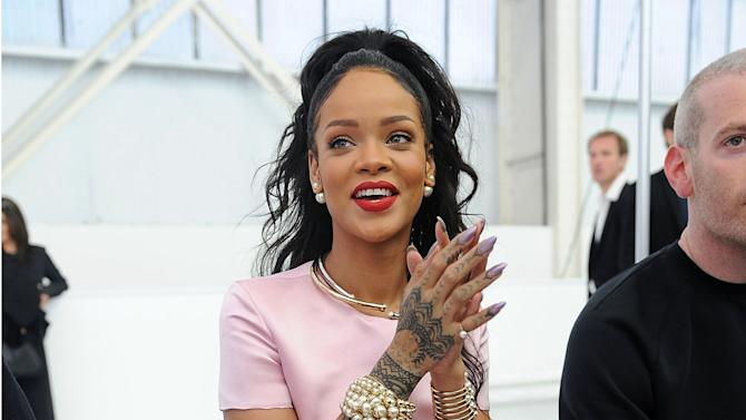 FILE - This May 7, 2014 file photo shows singer Rihanna with stiletto nails at the Dior Cruise 2015 Fashion Show at the Brooklyn Navy Yard in New York. Rhinestones, 3-D designs, textured topcoats and new offerings from fashion royalty have upped the ante on fingertips. Stiletto nails extension, gels or natural nails that are sharpened at the tip. (Photo by Brad Barket/Invision/AP, File)