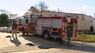 Fire and police trucks were parked at 2 Point Douglas Avenue on Sunday afternoon.