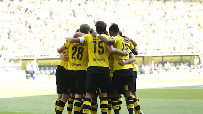 Borussia Dortmund's players celebrate a goal against Hertha Berlin during their Bundesliga first division soccer match in Dortmund