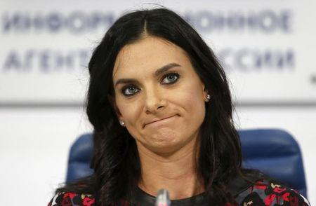 Russian pole vaulter Isinbayeva attends during a news conference in Moscow