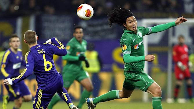 Wigan's Roger Espinoza, right, is challenged by Maribor's Martin Milec during their group D Europa League soccer match, in Maribor, Slovenia, Thursday, Dec. 12, 2013