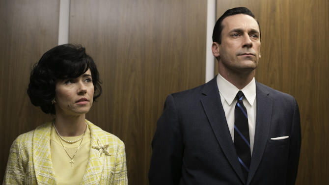"This TV publicity image released by AMC shows Linda Cardellini as Sylvia Rosen, left, and Jon Hamm as Don Draper in a scene from ""Mad Men."" The season finale airs Sunday, June 23, on AMC. (AP Photo/AMC, Jordin Althaus)"