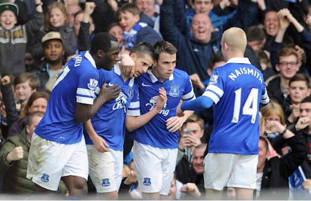 Everton's Kevin Mirallas second left, celebrates with team-mates Leighton Baines second right, Romelu Lukaku left, and Steven Naismith after he scored the second goal of the game for his side duri