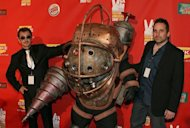 "Bioshock Creative Directors Greg Gobbi (L) Ken Levine (R) pose with the ""Bioshock"" character at Spike TV's 2007 ""Video Game Awards"" in Las Vegas. Take-Two Interactive Software said on Wednesday that release of a much-anticipated ""BioShock Infinite"" videogame was postponed into early next year"