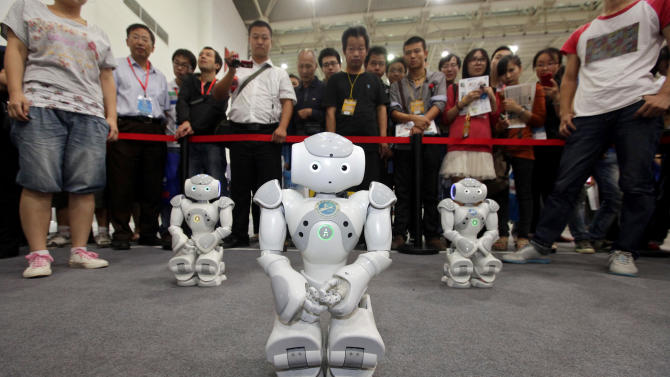Robots dance for the visitors at the 13th China International Machinery and Electronic Products Expo in Wuhan