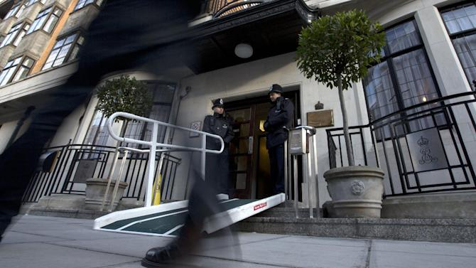 Two policemen stand guard outside the King Edward VII hospital where Kate Duchess of Cambridge is receiving treatment in central London, Wednesday, Dec. 5, 2012. Prince William and his wife Kate are expecting their first child, and the Duchess of Cambridge has been admitted to hospital suffering from a severe form of morning sickness in the early stages of her pregnancy.  (AP Photo/Alastair Grant)
