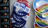 "US President Barack Obama's campaign pins are sold in Charlotte, North Carolina, September 2, 2012. Obama accused Republican foe Mitt Romney of failing to offer ""a single new idea"" and of being a relic of the last century as he revved up a pre-convention tour"
