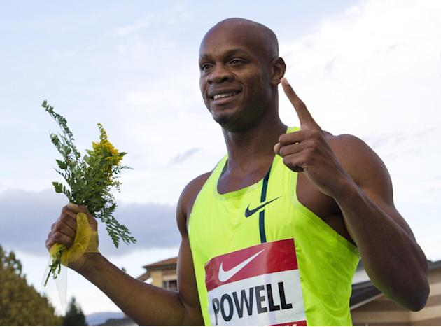 FILE - In this Sept.7 2014 file photo, Asafa Powell celebrates after winning the men's 100 meters competition at the IAAF Grand Prix in Rieti, Italy. Usain Bolt's Jamaica teammate Asafa Powell bel