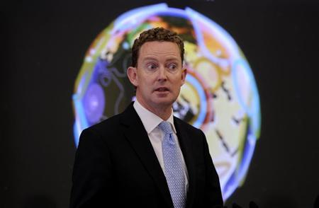British Climate change minister Barker speaks in front of a new interactive Google Earth map in London