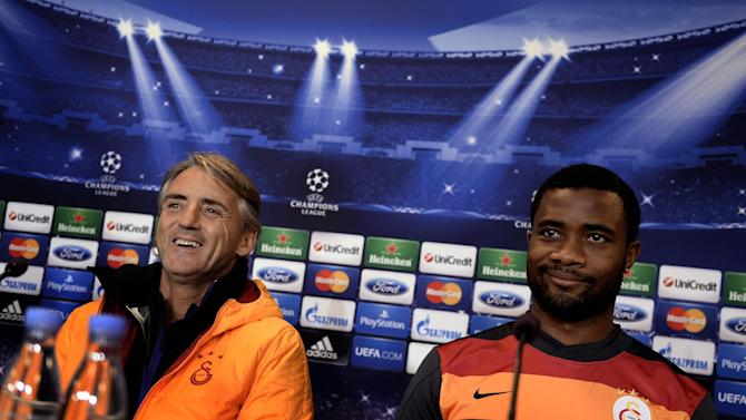 Galatasaray AS's coach, Roberto Mancini, left, and Aurelien Chedjou during a press conference prior to the Champions League soccer match against FC Copenhagen at Parken Stadium in Copenhagen, Denmark, Monday, Nov. 4, 2013