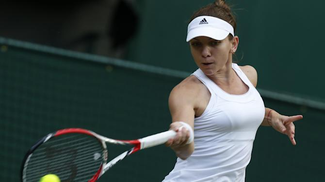 Wimbledon - French Open runner-up Halep battles through to third round