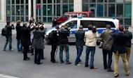 Journalists take pictures of a Police car transporting Canadian porn actor Luka Rocco Magnotta as he leaves the main detention center in Berlin on June 5. New videos circulating on the Internet of the Canadian porn actor appear to be credible, but a probe is ongoing, Montreal police said Wednesday